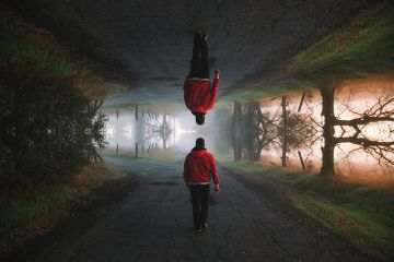 upsidedown mirroreffect man road walkway